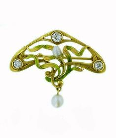 A wonderful Art Nouveau pin of 14 karat yellow gold, fabricated in the United States, having a floral inspired design with delicate pink and green enameling. Its fluid gold frame is emphasized by three Old European cut diamonds and two baroque pearls accentuate the floral applique..