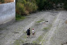 Josh Roberts, 15, at left, and Carlos Gomez, 13, both of San Jose, explore the dried up Guadalupe River near Santa Clara Street in San Jose, Calif., on Monday, July 11, 2015. (Jim Gensheimer/Bay Area News Group)