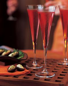 Cranberry Kir Royale 8 tablespoons frozen cranberry juice cocktail concentrate, thawed 1 1/3 cups chilled Champagne