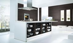Maximise space with a #kitchen island. You can use it for storage, appliances & fittings. #KitchenTips