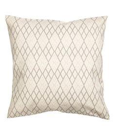 Luonnonvalkoinen/Beige. Painokuvioinen tyynynpäällinen puuvillaa. Piilovetoketju.