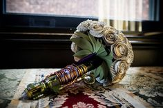 Wedding bouquet made with a Doctor Who sonic screwdriver and pages out of Sherlock Holmes books. Awesome!