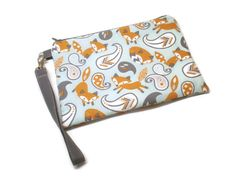 A personal favorite from my Etsy shop https://www.etsy.com/listing/255242357/foxes-iphone-wristlet-purse-with-credit