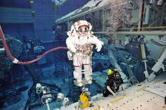 """Samantha Cristoforetti undergoing """"training for spacewalks in NASA's Neutral Buoyancy Laboratory in Houston, USA. Diving underwater is as close as it gets to experiencing weightlessness on Earth for long periods of time.""""   Credits: NASA/ESA"""