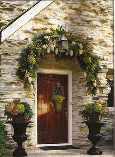 Incredible Christmas decor! So rich and so inviting! Moss is always a welcome use, and the placement of the swag and door decor are so smart!