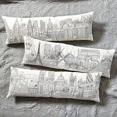 Embroidered City Skyline Pillow -- to use as decorative or lumbar cushion in sofa or reading chair? I love how these are decorative and interesting but not loud.