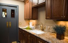 Upper level laundry room with granite counter tops