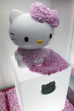 In the money: A Sanrio Co. Hello Kitty figure arranged by Japanese model Ai Tominaga is displayed at the Swarovski 'House of Hello Kitty' event at Omotesando Hills in Tokyo on June 29, 2011. | BLOOMBERG
