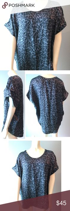 JOIE Silk Animal Leopard Print Joann C Oversized This is a animal print silk top by Joie in XS. It is a buttery soft silk satin in different shades of gray. It could easily fit a larger size, see measurements. The shirt tapers in a little to the hips.