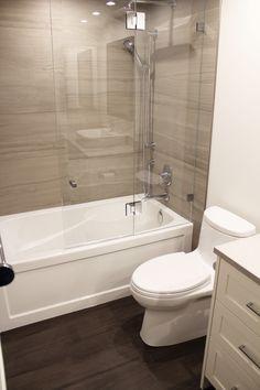 "Beautiful Bathroom Renovation Project Featuring 18"" x 36"" Porcelain Wall Tiles, 18"" x 36"" Porcelain Floor Tiles, Riobel Shower Fixtures, Mirolin Tucson Bathtub, TOTO Toilet, Caesarstone Quartz Vanity Top With Custom-made Vanity, Custom Frameless Shower Glass, DXV top mount sink + faucet, And Floor heat by Nuheat."