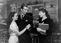 Movie still from the 1945 film 'Mildred Pierce', which features Joan Crawford as a hard working women who built an empire for her daughter played by Anna Blyth (left), Zachary Scott (center) portrays her semi-faithless husband