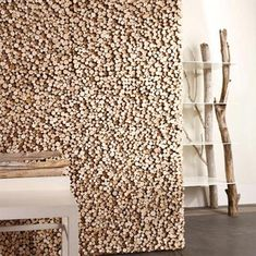 A unique wall covering made of rough-cut  wood pieces in differing lengths for a variegated surface. The use of mixed  woods creates a dappled effect of subtle color changes with natural appeal.