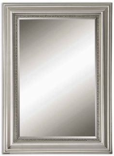 Stuart Silver Beaded Wall Mirror.  finehomelamps.com   37 x 27  $193.  This one for the larger bathroom mirror.