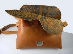 Cognac colored bag with blue wing print. $245.00, via Etsy.