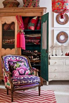 befairbefunky:    Etnic chic for an eclectic lifestyle/think this is in a bedroom but this chair would work in a living room as well...great textiles