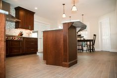 Do you like this porcelain plank floor tile for this kitchen project? - Design Build Pros