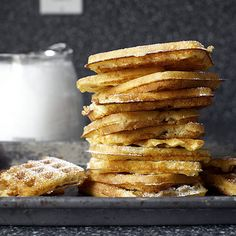"""Essential Overnight Raised Waffles Recipe - """"...a cross between the finest yeast doughnut you've ever sunk your teeth into and a rich brioche roll. The edges are as golden and crisp as the outermost layer of puffed pastry and the center is as rich as pudding but as airy as a soufflé. The aroma is that of freshly baked challah and the flavor is something of a malty croissant — not sweet, but so complete in its complexity, you might even forget to drizzle it with syrup."""""""