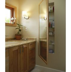 Hidden Storage. Full-length mirrors are a great addition to the bathroom - and even better when theyre hiding in-wall storage.