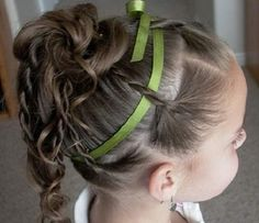 This would be adorable with pink ribbon in Leah's hair!  Doesn't look super difficult either :)