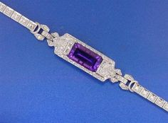 """White gold, Diamond & Amethyst Bracelet    Measures approx 7 1/2"""" in length. Ca 1920's. Center is set in platinum, & the band is 14K white gold. approx 1ctw in diamonds."""