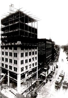 The current, 10 Story, Lowell Sun building under construction at 8 Merrimack Street, corner of Middlesex and Prescott Streets (1912). Also shown is Nelson's Colonial Department Store, Frederick E. Nelson Company Proprietors, at the corner of Merrimack and Central. Under Construction, Department Store, Massachusetts, Colonial, Multi Story Building, Louvre, Corner, Sun, Street