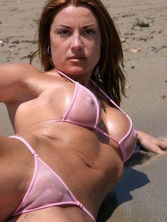 Summer posing near the waterline in a pink see through bikini!!