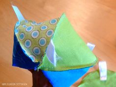 home-made soft baby toy with a simple free pattern -   Get your free PDF sewing patttern for a soft baby toy, with a step-by-step tutorial and lots of how-to photos. It's an easy beginner sewing project for a perfect baby-welcoming gift you can make in a really short time.