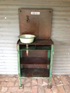 Vintage industrial water station custom made for a cafe. We used a vintage metal bowl to create the basin, together with a vintage tap and signage.