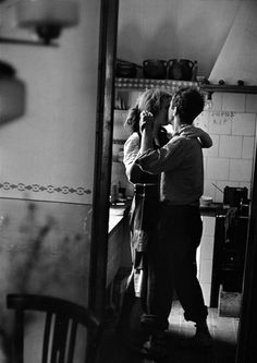 A couple dancing in their kitchen, 1950s
