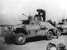 A Marmon-Herrington Mk 2 of the Divisional Cavalry at Maadi Camp during preparations for its despatch to Greece. At this stage it is in the standard desert scheme of sand, dark earth and dull-blue. The divisional insignia is carried on the hull side behind the radiator doors and the B Squadron insignia and troop number are found on both the turret and hull