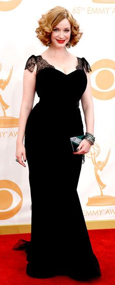 Christina Hendricks wowed in a black Christian Siriano dress with lace cap sleeves at the 2013 Emmy Awards