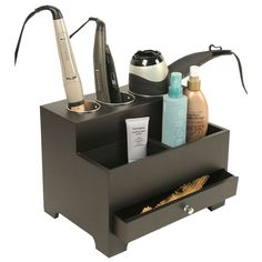 Hair Tool Organizer is made of black acrylic and has metal-lined storage holes for hot tools such as blow driers. It also has two open bns and a drawer.