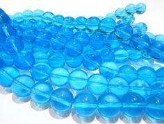 Cristal redondo liso, 12 mm, tira con 24  piezas, color azul turquesa, $35, Precios especiales a mayoristas.