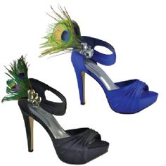 The Peacock is part of the exclusive Jonathan Kayne collection. This high heel sandal has a pleated front and an ankle strap. The ankle strap is adorned with large crystals and peacock featehrs. The Peacock is available in Black and Royal Blue and sizes include 5 - 11 medium.