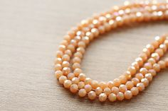 50 pcs of Electroplate Glass Faceted Plated Pale orange Round Glass - 3 mm