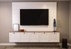 Wall mounting works great for big TVs, but a bare TV on the wall sure doesn't . Hiding Tv Cords On Wall, Hide Tv Cords, Wall Mounted Tv Console, Hanging Tv On Wall, Wall Mount Tv Cabinet, Tv Wall Mount, Backdrop Tv, Tv Wand, Tv Cabinet Design