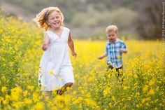 Children run in rapeseed field