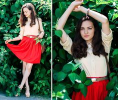 I adore the red skirt and gold necklace