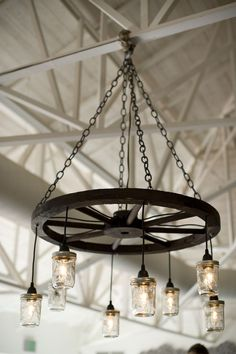 Wagon wheel chandeliers hung from the ceiling.  Venue:El Chorro  Event Planner: Sandy Walker ofIn Awe Weddings and Events