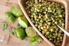 CILANTRO LIME CHICKPEA SALAD  2 cans chickpeas, drained and rinsed  4 loosely packed cups fresh spinach  1/2 onion, chopped small  juice from 4 limes  1 bunch of cilantro  3 Tbsp sugar  2 Tbsp dijon mustard  2 cloves garlic grated  1/2 Tbsp chili powder  1/2 cup olive oil
