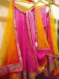 Impression: Zari Jaipur One of my favorites for a mehendi function. This gorgeous mango yellow orange with pink leheriya lehenga is the perfect pick this wedding season.