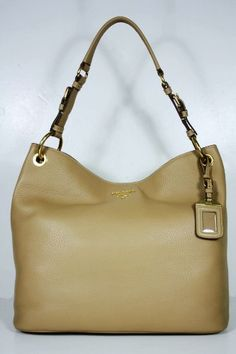 This authentic Prada Beige Leather BN4892 Handbag comes directly from designer boutiques