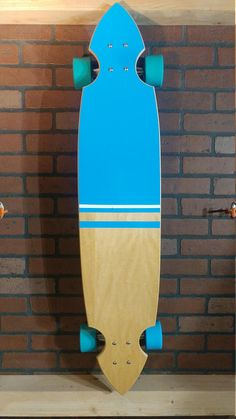 For sale is a Maple top with blue and white vinyl and Family Guy bottom, custom, one off, handmade, bottom mount, longboard by a professional longboard designer and builder . Dimensions are 9.5W x 45L x /9/16H. Ride height is 4 7/8.The board is made of 9 alternating layers of maple,