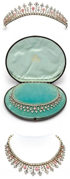 Tiara adorned with diamonds and pearls, and it features a very rare collection of beautiful pink conch pearls. With the original accompanying diamond-mounted attachment, the tiara easily converts to an elegant and stunning necklace. The set is offered in the original fitted box.