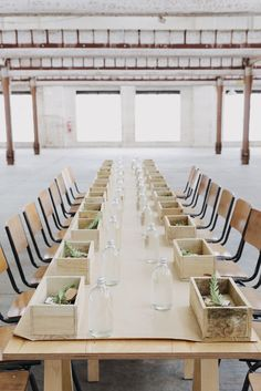 Kinfolk Workshop | Minimalist group entertaining | long unstained wood table with gift boxes + glass bottles