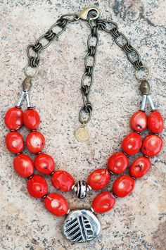 Make a statement with this bold orange coral necklace!
