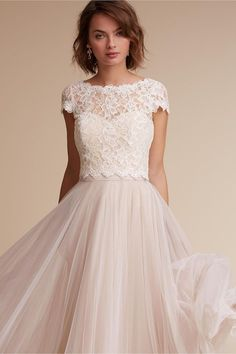 The sweet, scalloped Sydney Topper designed by Tadashi Shoji, turns into a darling two-piece wedding dress when paired with any number of skirts. We love this somewhat blush, off white bottom!