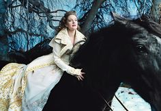 Photo shoot  by Annie Leibovitz. Theme:  Beauty and The Beast  with   DREW BARRYMORE.   (Vogue 2005)