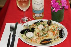 Seafood platter with fresh mussels, clams and shrimp served over linguini and paired with Trapiche Pinot Grigio.