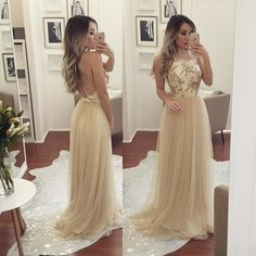 This champagne long dress would look amazing for any special occasion. It features the halter neckline with sequined bodice , open back and floor length tulle skirt . $177